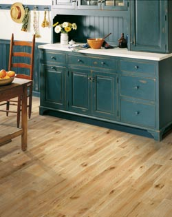 wooden, teal  kitchen cabinets - wooden table on hardwood floor