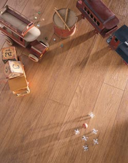 wooden toys on a brown laminate floor